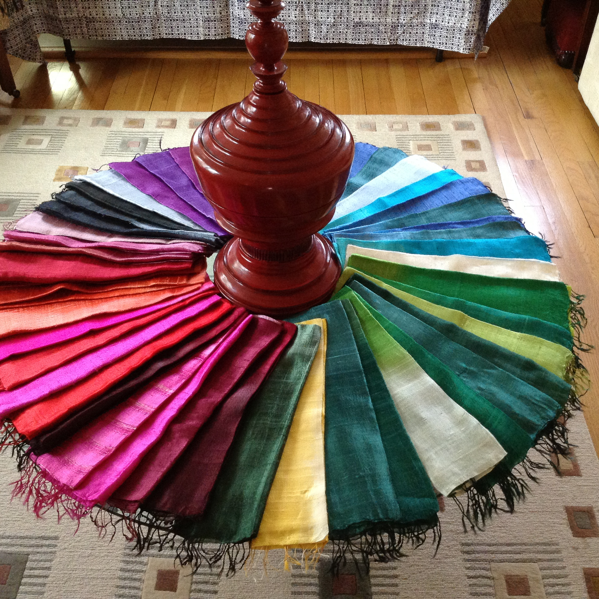 Fair trade products from artisans in Thailand, Burma and India, including silk and cashmere scarves, Thai clothing, and silver and other jewelry.