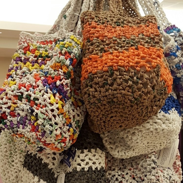 Hand crocheted tote bags made from recycled plastic; regular and beach bag sizes, wine bottle bags and small cross body bags; kitchen scrubbies also available.