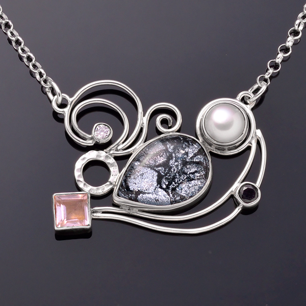 Robin's signature style combines bright metal and colorful glass to create unique and lasting designs.